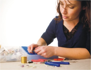 woman making jewelry