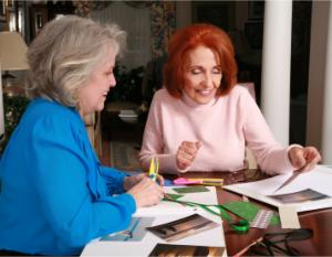two ladies enjoying their scrapbooking